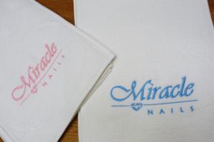 Ręczniki z haftem logo firmy.